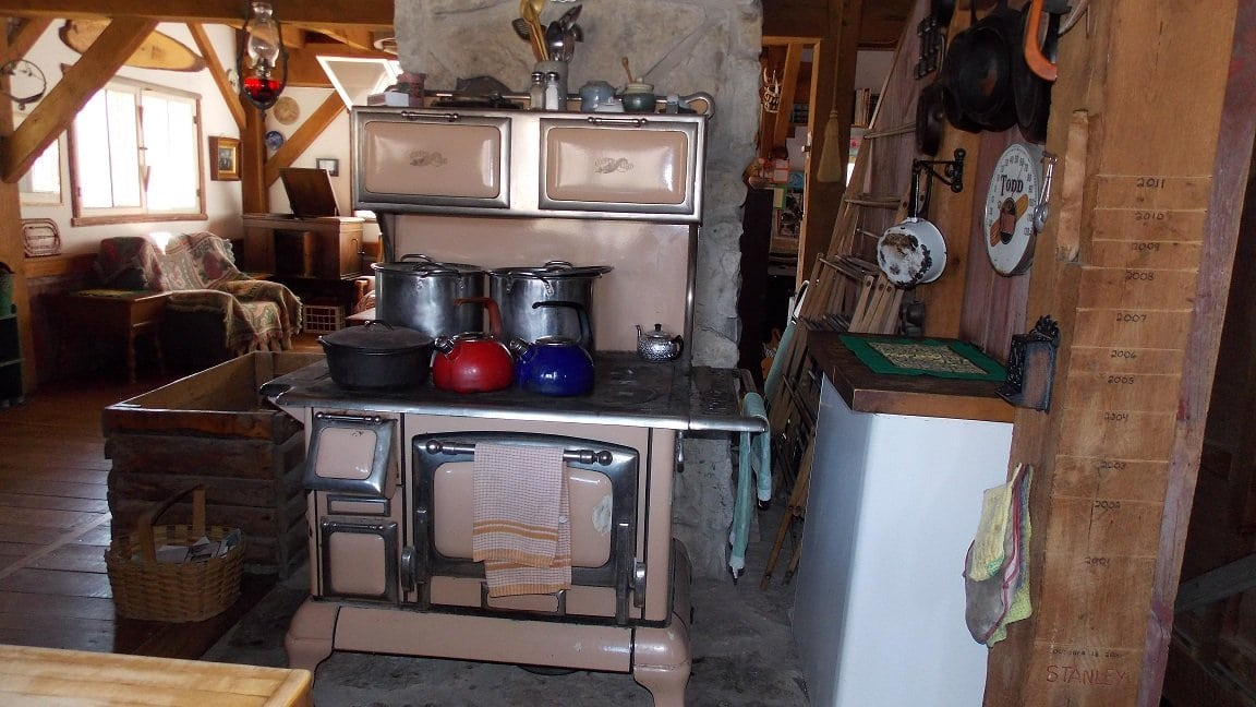 The wood cook stove is a true antique refurbished by a professional