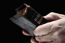 Man hands holdig Bible