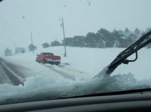 red truck in ditch