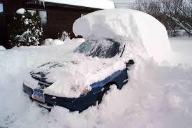 snow buried car